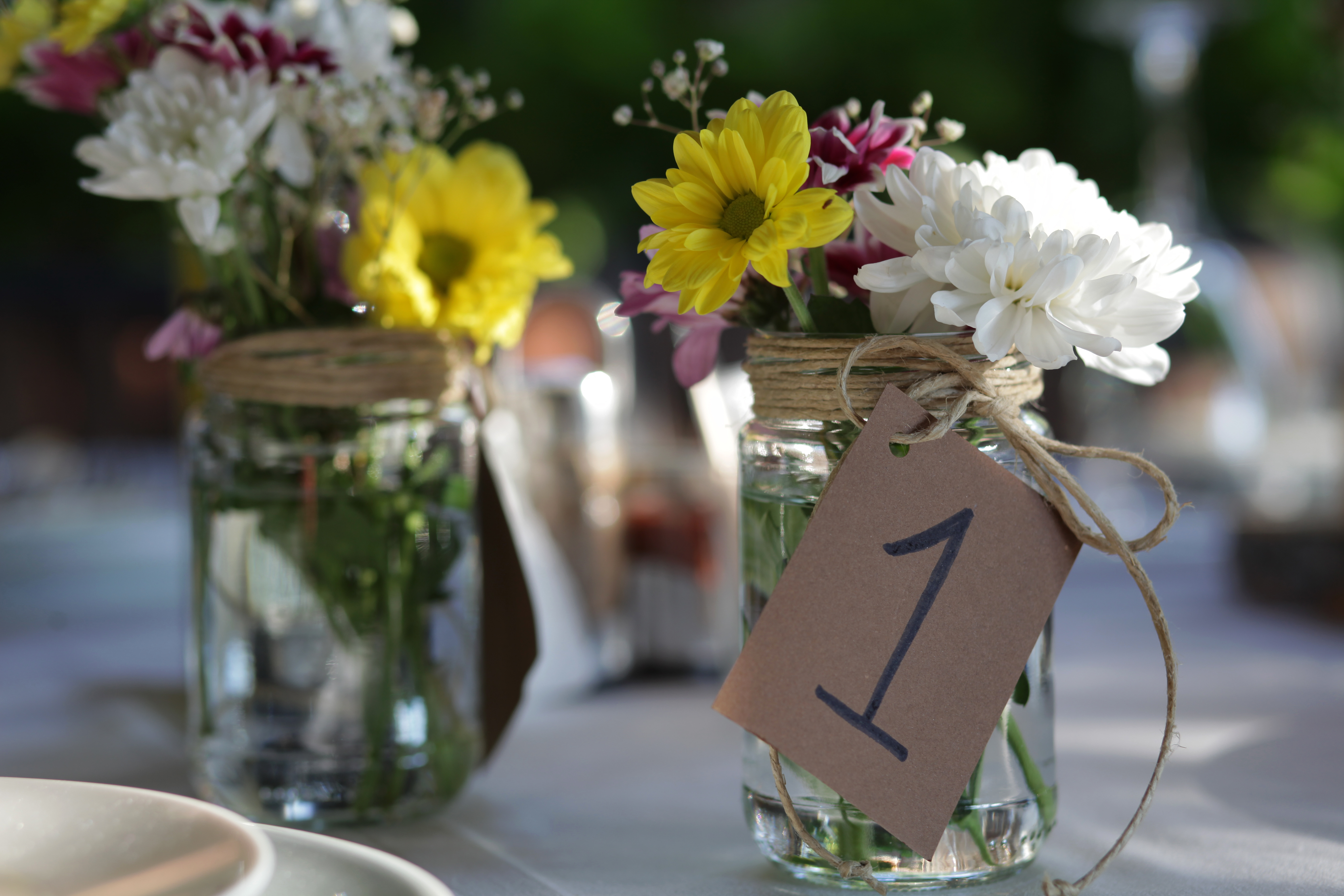 Floral decor in a jar on the table for the wedding ceremony